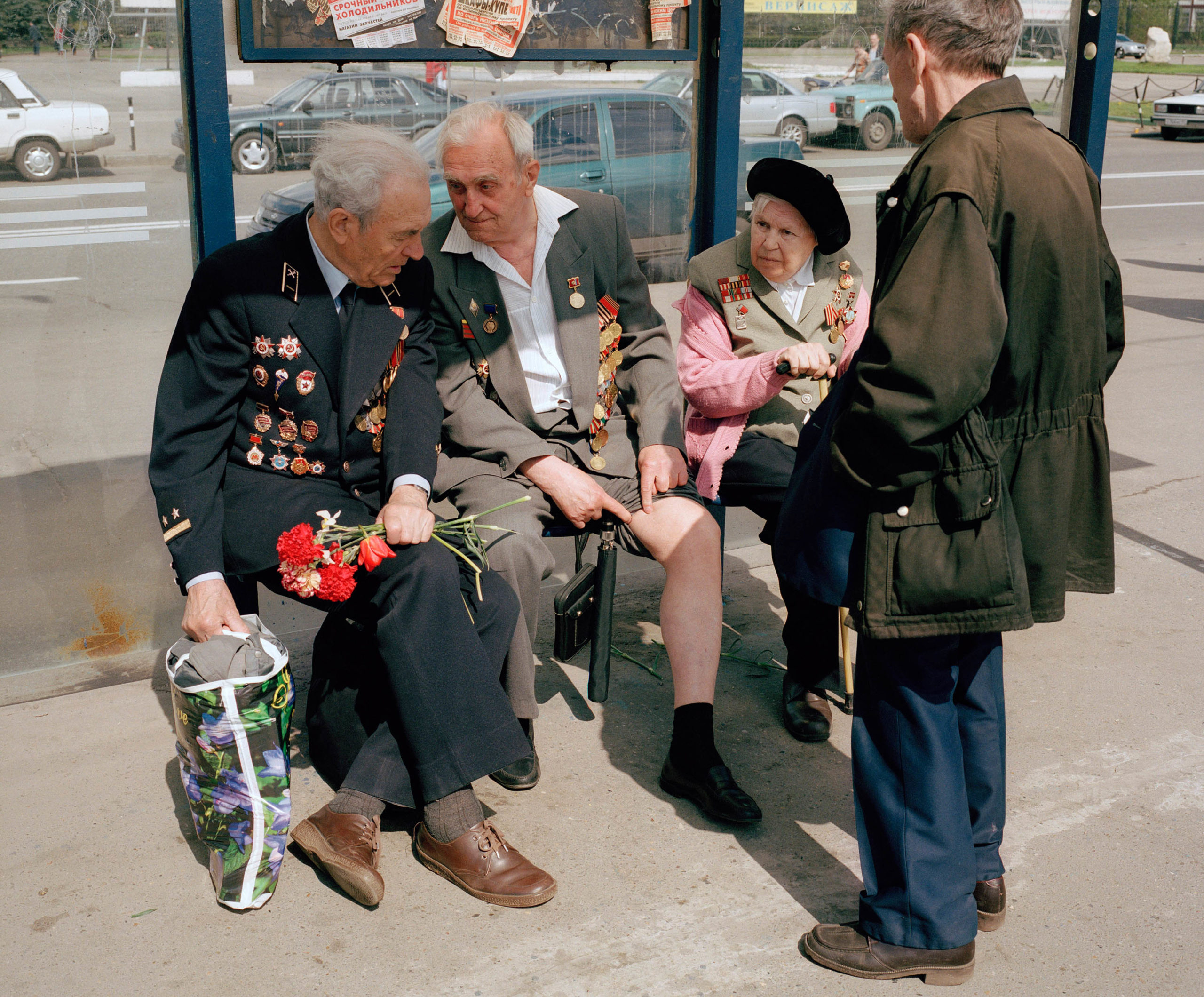 Russia, Moscow. Victory Day. War veteran shows his old war wounds.