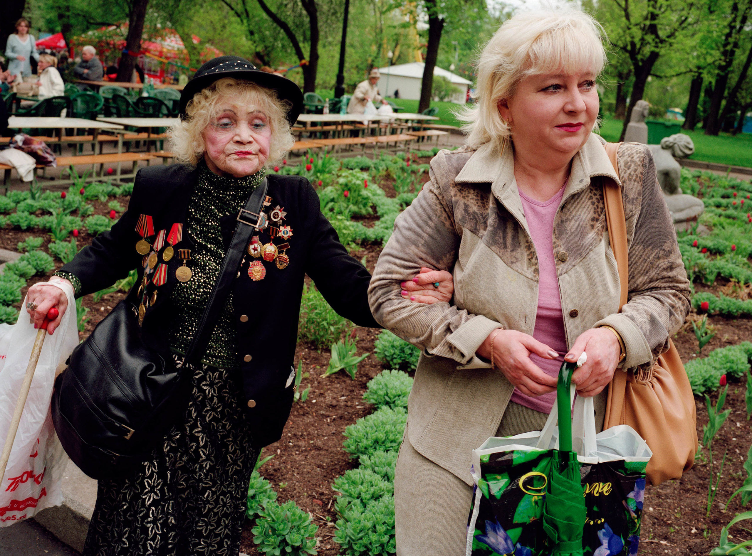 Russia, Moscow. Victory Day. After the celebrations, a tipsy veteran is picked up by her daughter.