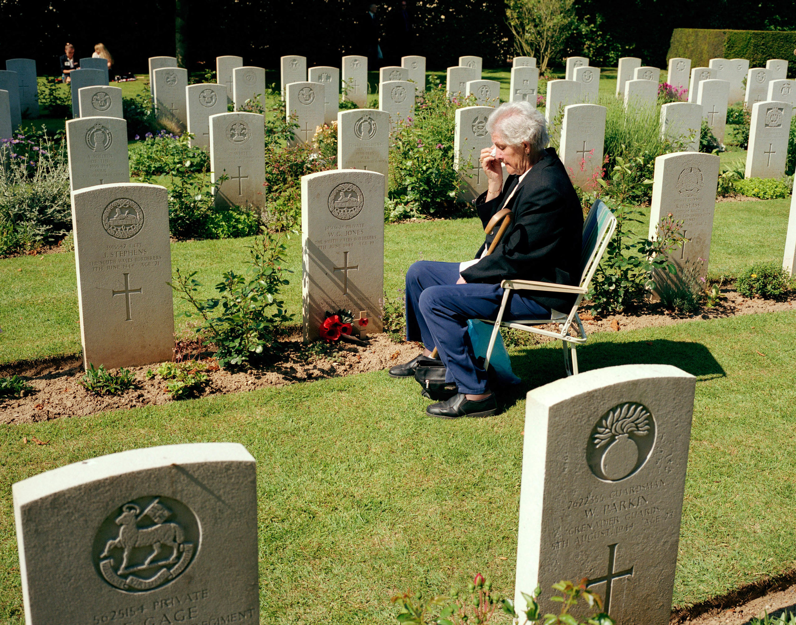 Normandy, Bayeux. D-Day celebrations. At the British war cemetery, a British woman mourns at the grave of her brother, who was killed on 7 June 1944.