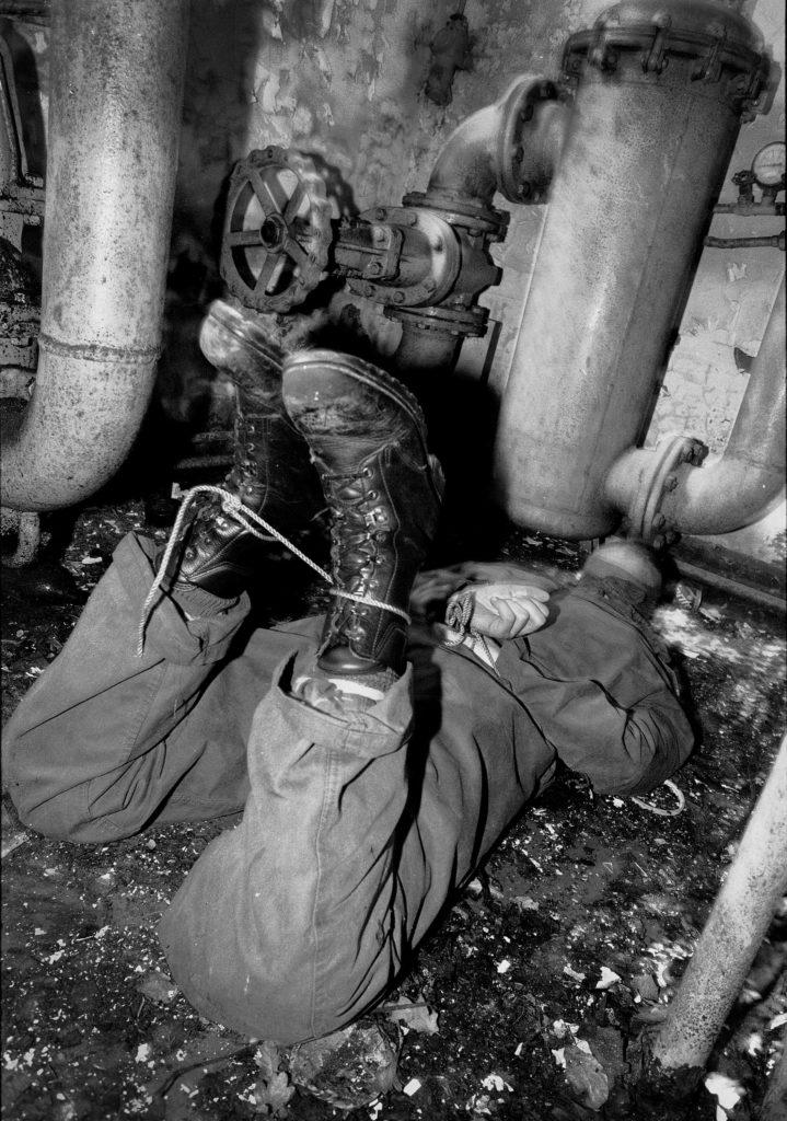 'Prisoner' is held for hours in a stress position. NATO exercise Weelde, Belgium, 2000