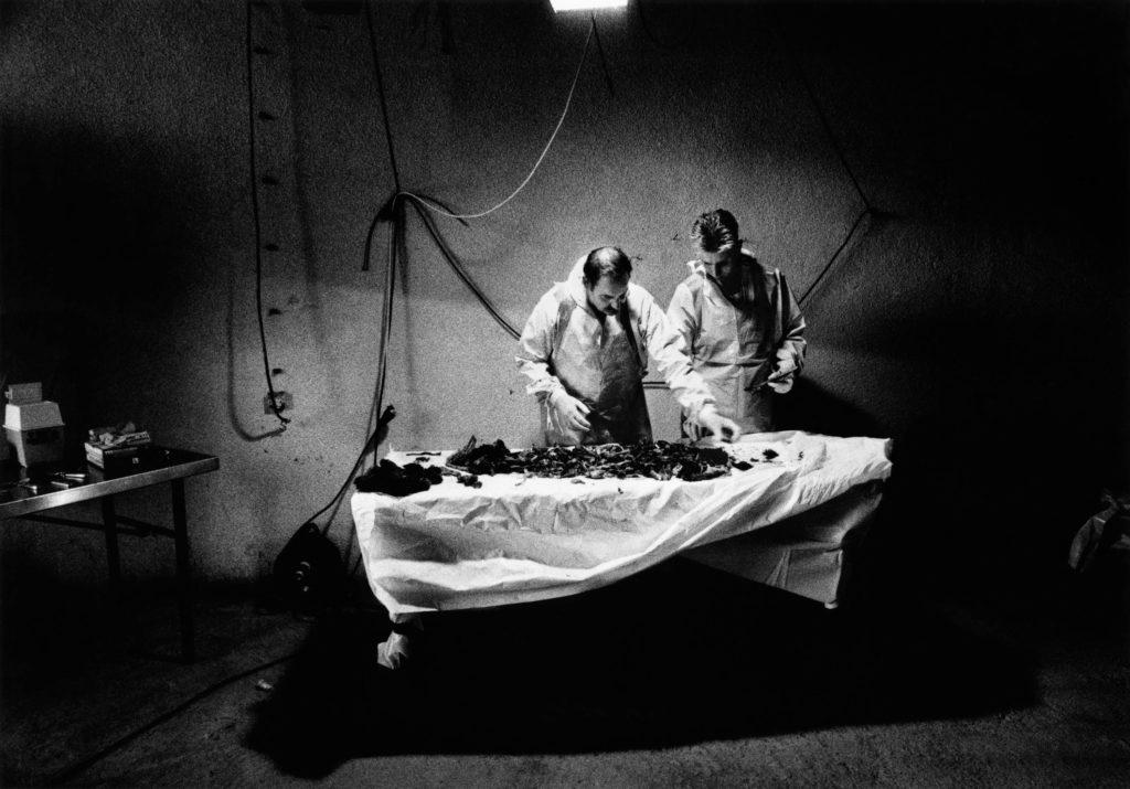 Yugoslavia Tribunal investigators collect evidence of Serbian warcrimes from bodies from a massgrave. Suva Reka, Kosovo, 1999