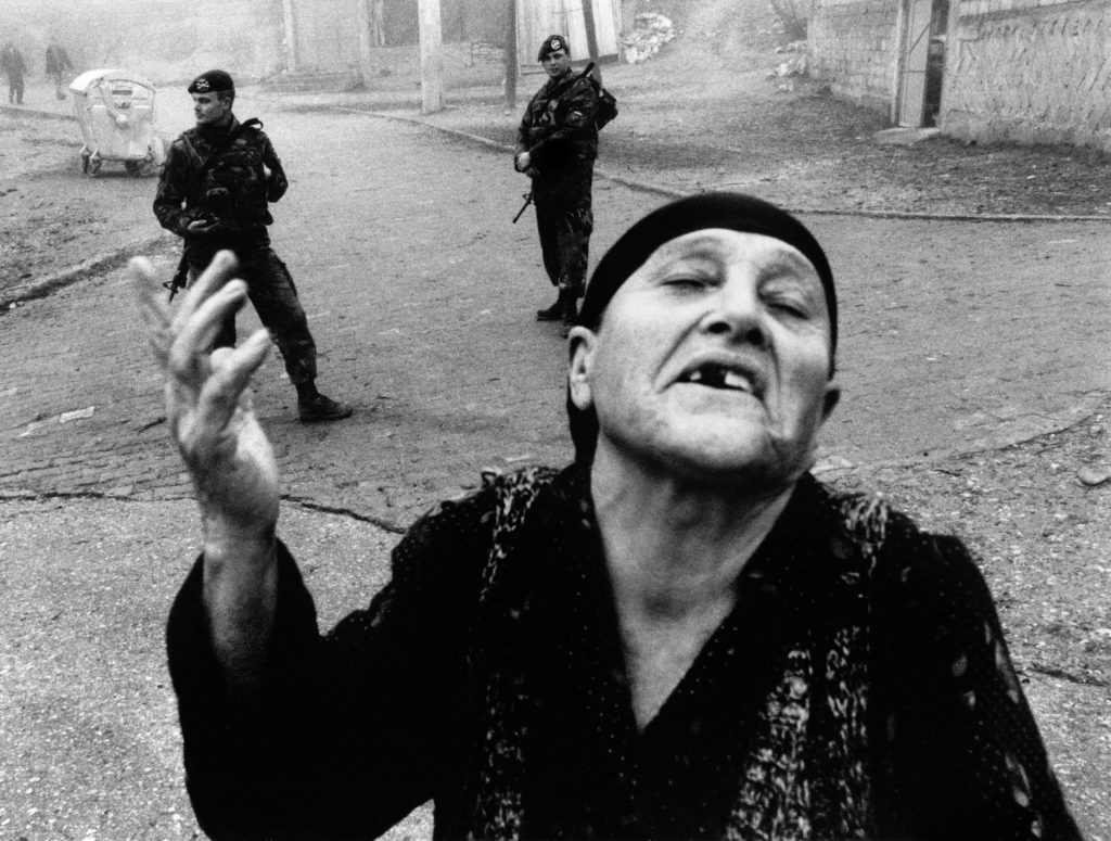 Serbian woman and Dutch troops. Orahovac, Kosovo, 1999