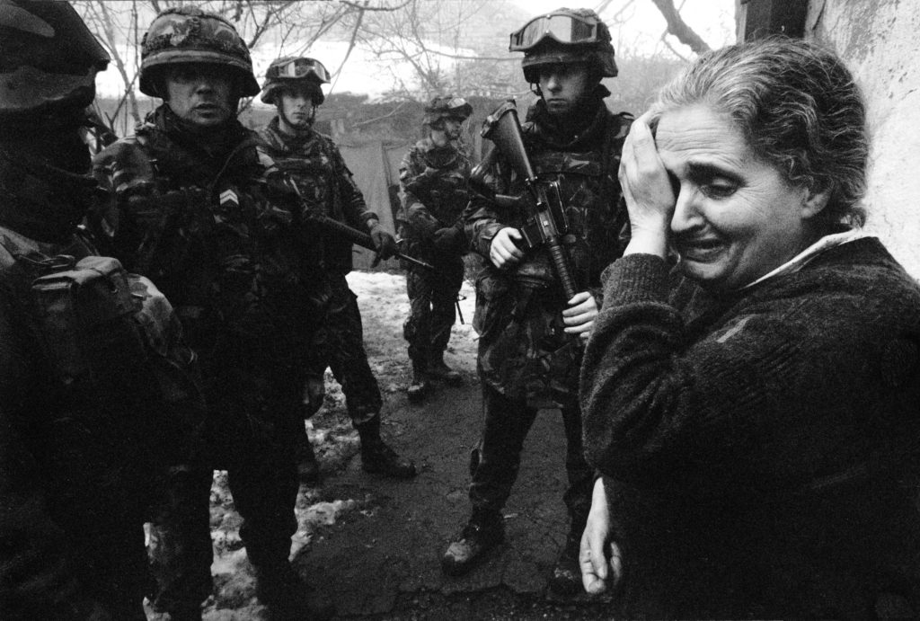 Serbian woman is afraid of Albanians who want to take her house. Mitrovica, Kosovo, 1999
