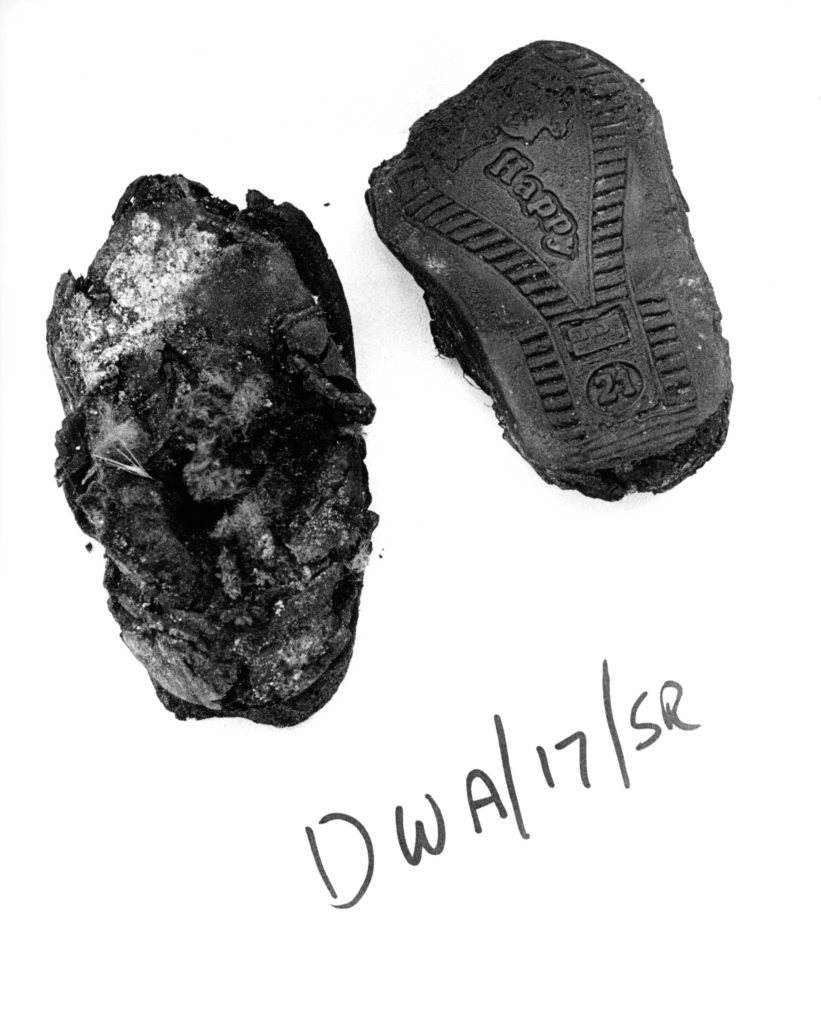 Child's foot and shoe from a massgrave. Suva Reka, Kosovo, 1999