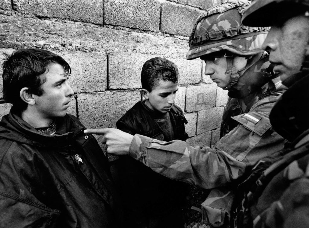Albanian looters apprehended by Dutch troops. Mitrovica, Kosovo, 1999