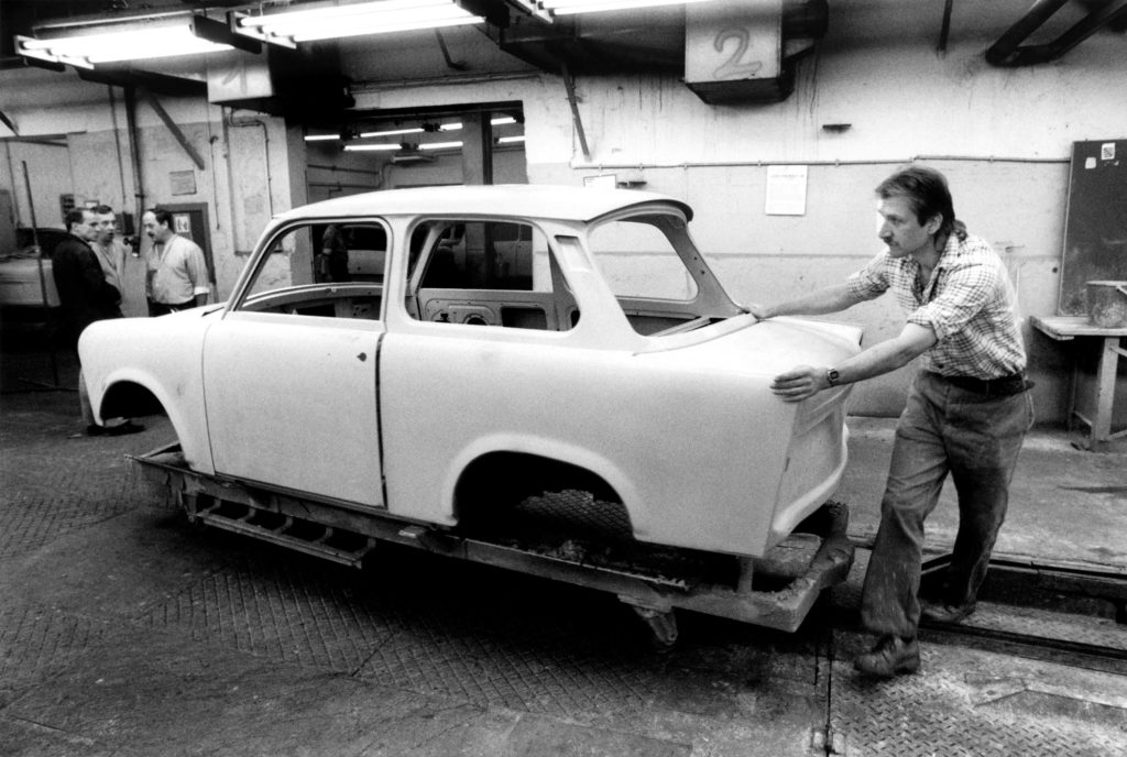 Unfinished Trabant being pushed along for further work, 1990